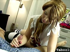 Pigtailed 18 year venerable gives a handjob in bed